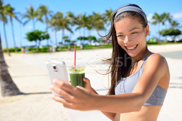 Stock photo: Fitness selfie woman drinking green smoothie