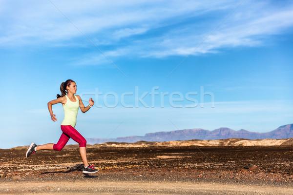 Trail runner athlete running in nature mountains Stock photo © Maridav