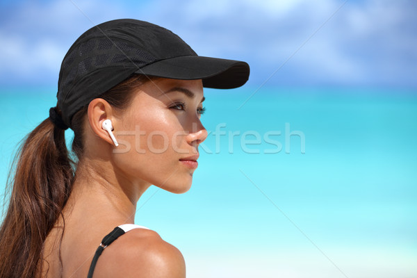 Wireless earbuds running woman on fitness workout Stock photo © Maridav