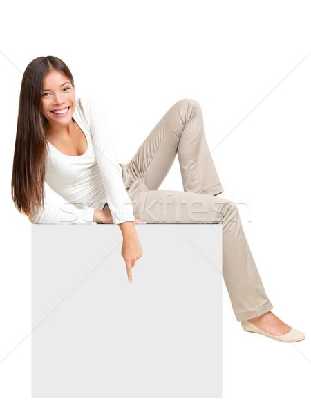 Woman sitting on / showing sign Stock photo © Maridav