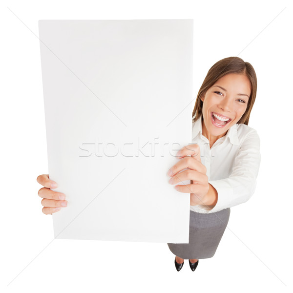 Businesswoman with blank sign excited Stock photo © Maridav