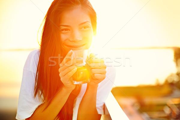 Asian woman drinking coffee in sun Stock photo © Maridav