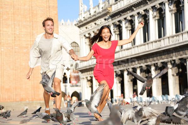 Couple in love having playful fun in Venice Stock photo © Maridav