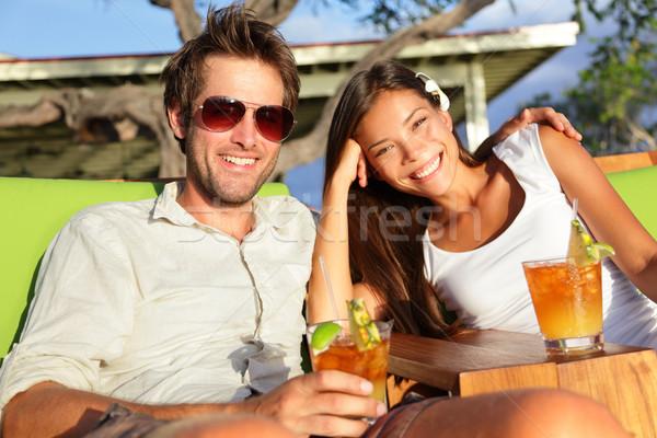 Couple drinking alcohol at beach club having fun Stock photo © Maridav