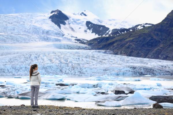 Adventure woman by glacier nature on Iceland Stock photo © Maridav
