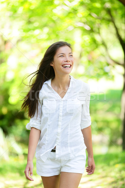 Happy Young Woman Looking Away In Park Stock photo © Maridav