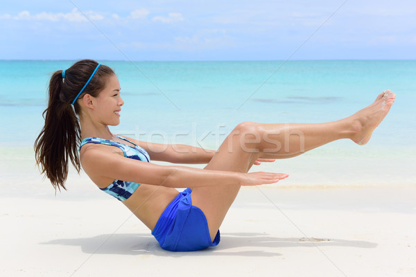 Fitness woman exercising abs with sit-ups workout Stock photo © Maridav