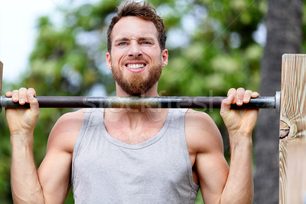 Crossfit fitness man exercising chin-ups workout Stock photo © Maridav