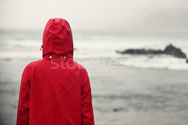 Spadek kobieta deszcz patrząc ocean szary Zdjęcia stock © Maridav