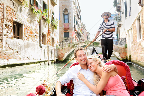 Stock photo: Romantic travel couple in Venice on Gondole boat