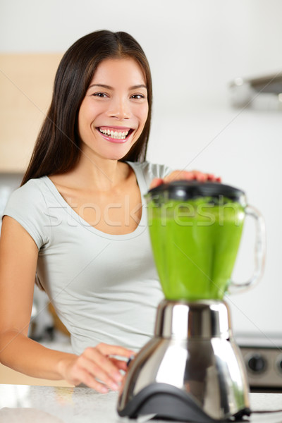 Smoothie woman making vegetable green smoothies Stock photo © Maridav