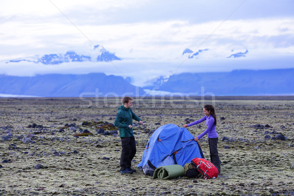 Camping couple pitching tent after hiking Stock photo © Maridav
