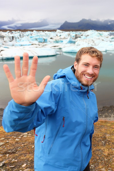 Tourist waving hand by Jokulsarlon on Iceland Stock photo © Maridav