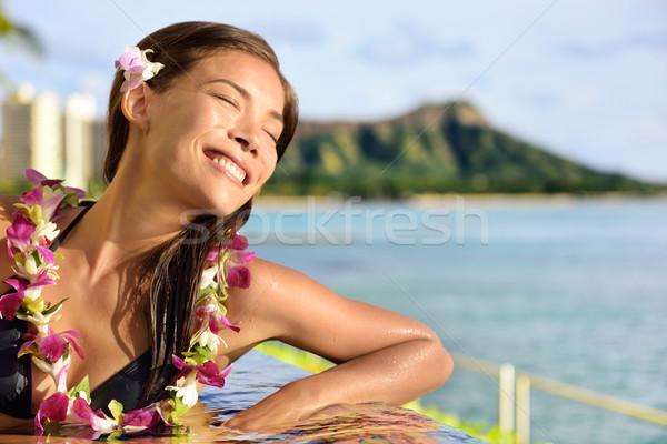 Holiday woman relaxing enjoying sun at pool resort Stock photo © Maridav