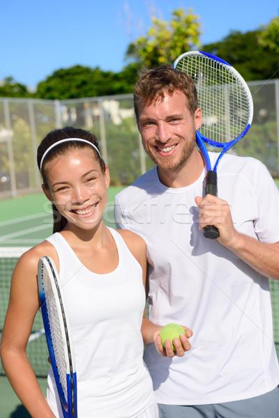 Tennis sport - Mixed doubles couple players Stock photo © Maridav
