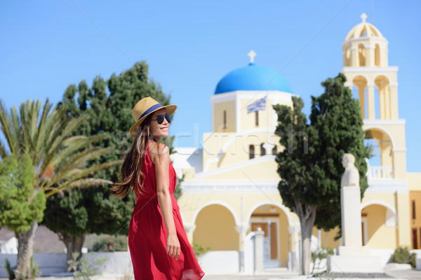 Santorini happy tourist woman at blue dome church Stock photo © Maridav