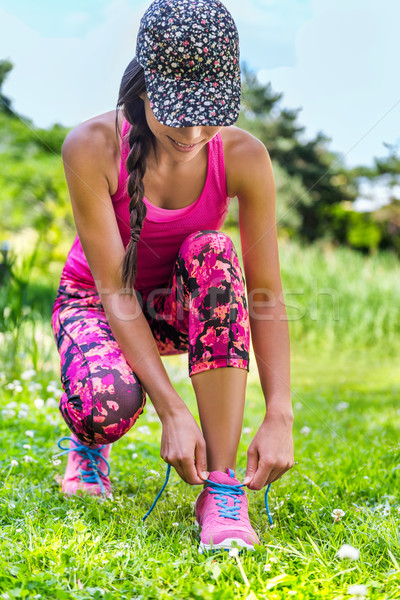 Fashion running activewear runner girl tying shoes Stock photo © Maridav