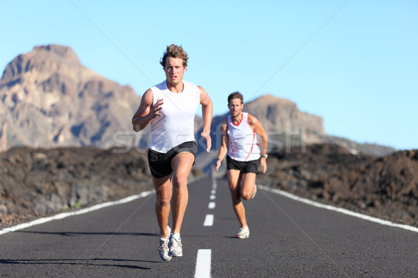 Stock photo: Runners running on road