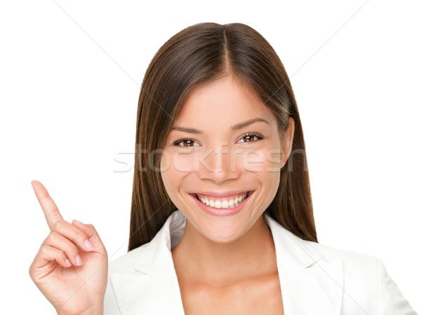 Indicação para cima mulher mulher sorrindo cópia espaço Foto stock © Maridav