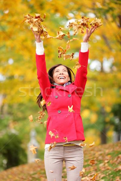 Happy fall woman throwing leaves Stock photo © Maridav