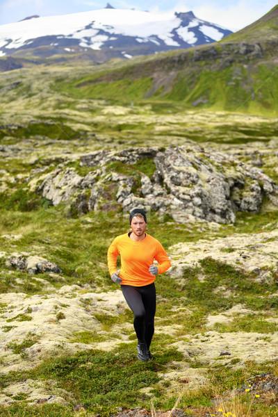 Trail running man in cross country run Stock photo © Maridav