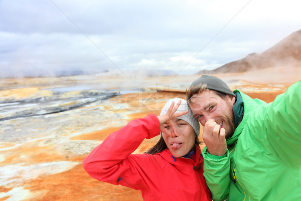 Iceland funny tourists selfie at mudpot hot spring Stock photo © Maridav