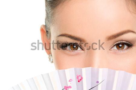 Asian beauty eyes - makeup woman looking with fan Stock photo © Maridav