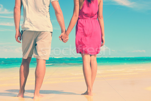 Low Section Of Couple Holding Hands On Beach Stock photo © Maridav
