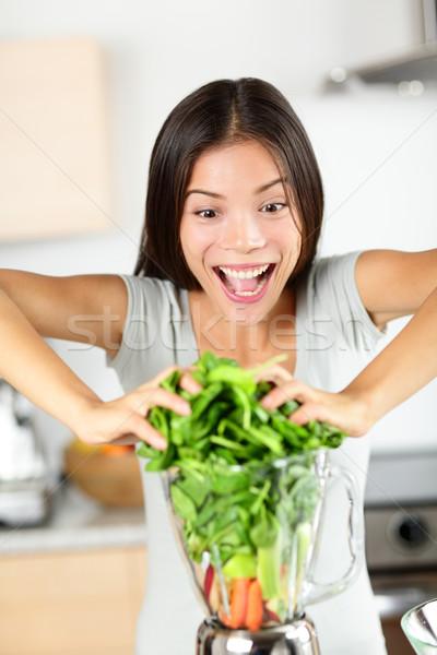 Vegetable smoothie woman making green smoothies Stock photo © Maridav