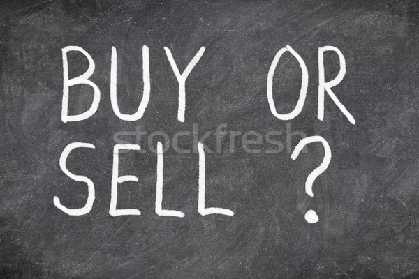 Buy or sell question on blackboard Stock photo © Maridav