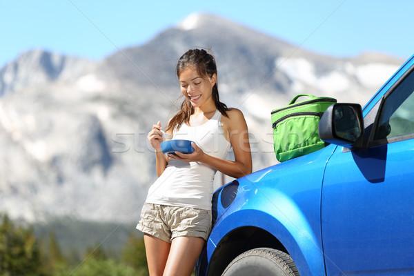 Car road trip woman eating in Yosemite Park Stock photo © Maridav