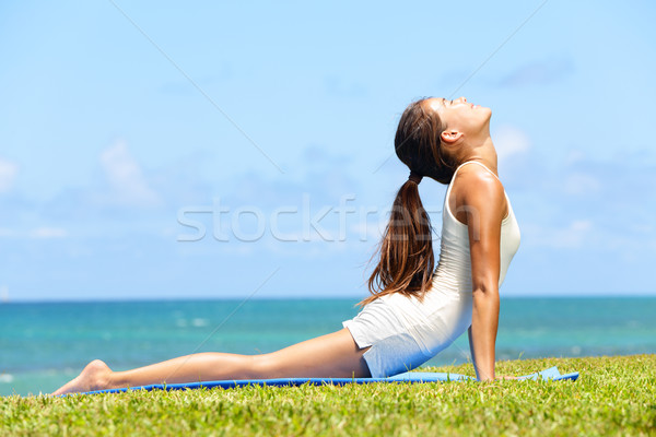 Fitness yoga woman stretching in cobra pose Stock photo © Maridav