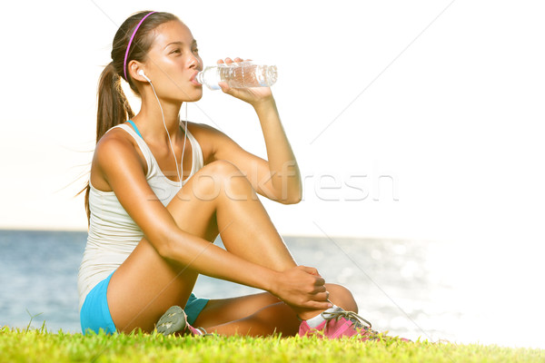 Stock photo: Fitness woman drinking water after workout outside