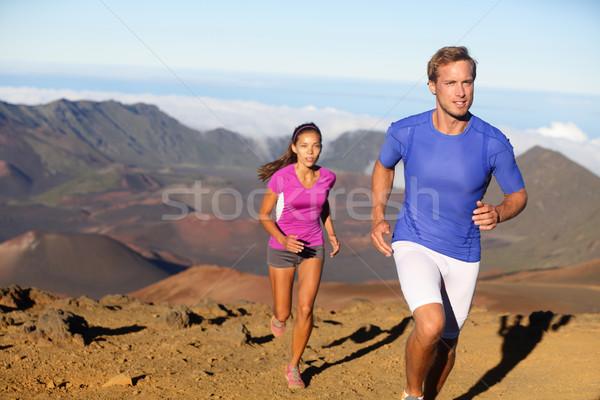 Running sport - trail runners in cross country run Stock photo © Maridav