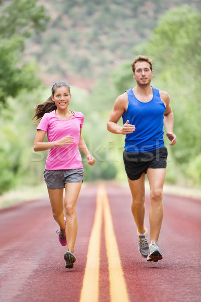Running people - two smiling runners jogging Stock photo © Maridav
