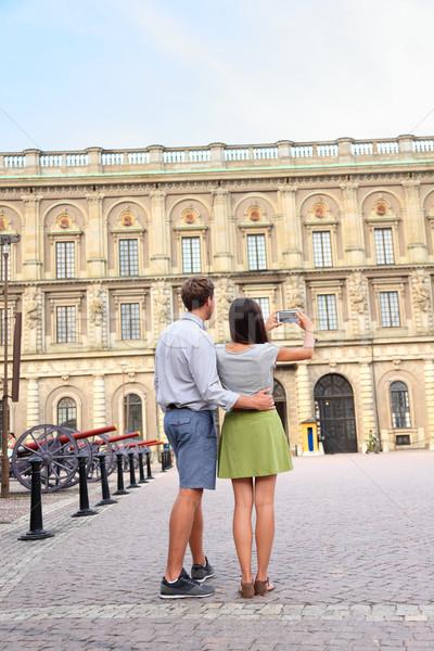 Tourists taking photo of Stockholm Royal Palace Stock photo © Maridav