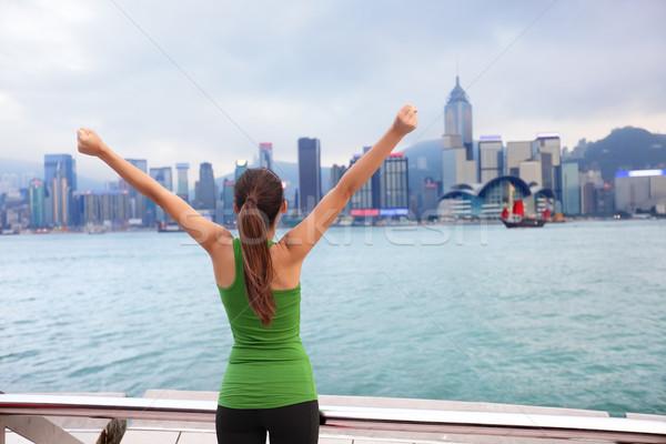Heureux femme succès Hong-Kong Skyline Photo stock © Maridav