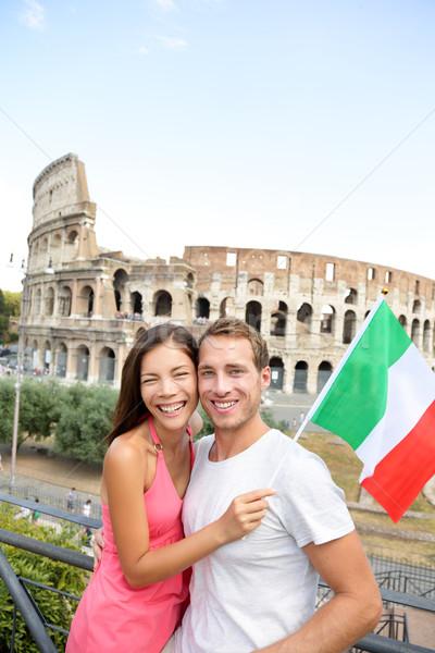 Happy tourists in front of Coliseum, Rome, Italy Stock photo © Maridav