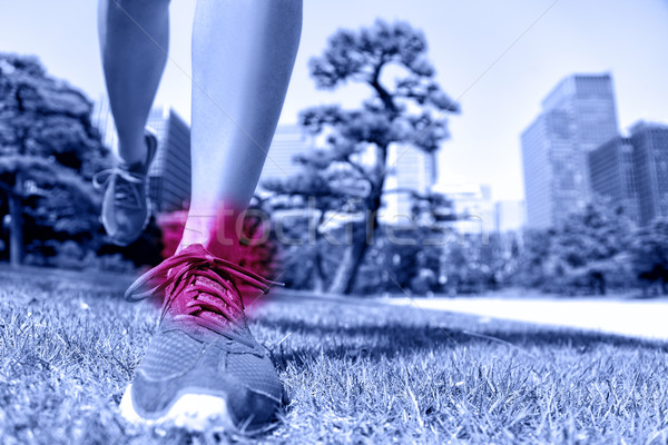 Sports injury - runner feet with ankle pain Stock photo © Maridav