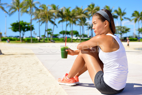 Stock photo: Healthy woman runner drinking green smoothie