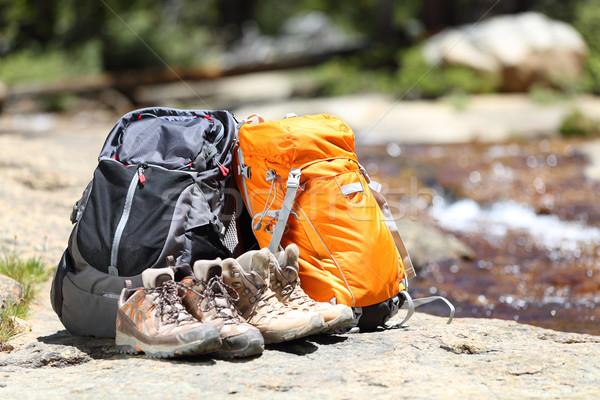 Hiking backpacks and hiker shoes Stock photo © Maridav