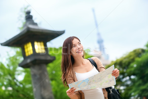 Travel in Tokyo - Asian tourist woman with map Stock photo © Maridav