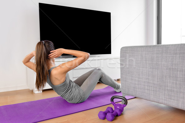 Home Fitness Frau beobachten Training Videos Stock foto © Maridav