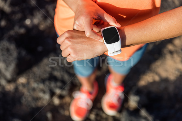 Trail runner athlete using smart watch cardio app Stock photo © Maridav