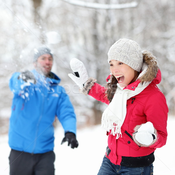 Winter fun - couple in snowball fight Stock photo © Maridav