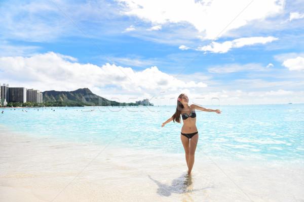 Happy beach woman in bikini on Waikiki Oahu Hawaii Stock photo © Maridav