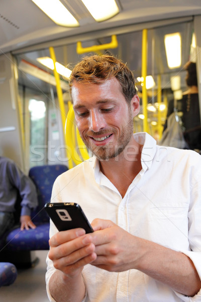 Subway businessman texting sms on smartphone app Stock photo © Maridav