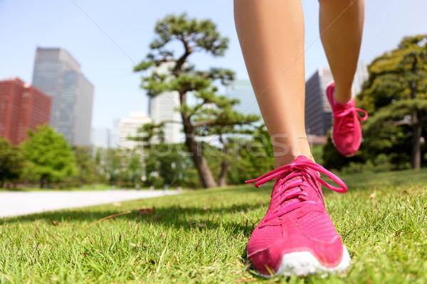 Running shoes - woman jogging in Tokyo Park, Japan Stock photo © Maridav