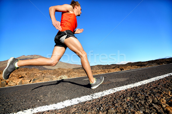 Runner man running sprinting for success on run Stock photo © Maridav