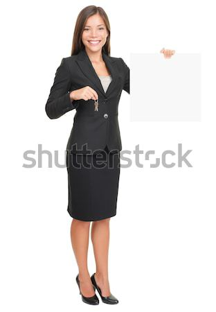 Real estate agent showing sign Stock photo © Maridav